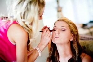 a woman having make up done